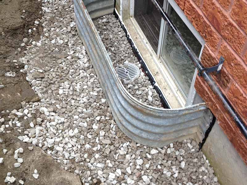 window well drainage installation | PH Group Waterproofing Specialists | Barrie Ontario