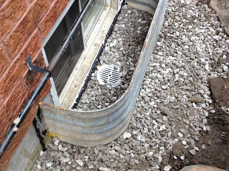 window well repair and drainage installation